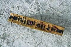 spilla,1961.oro-niello-rubinochia